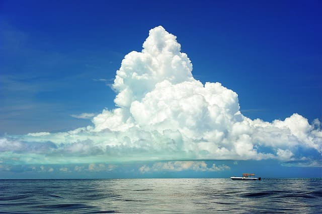 Clouds over the sea, with boat.